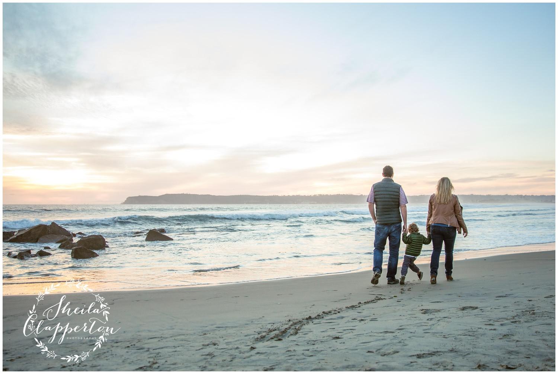 family of three on coronado beach