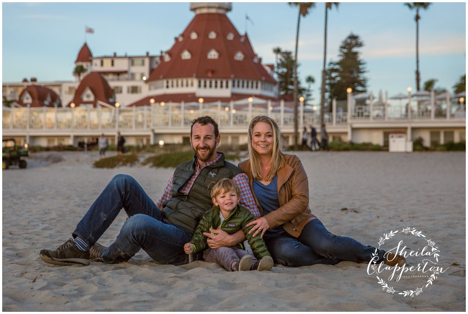 family of three on coronado beach